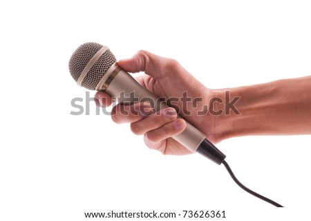 Hand Holding a Microphone - stock photo