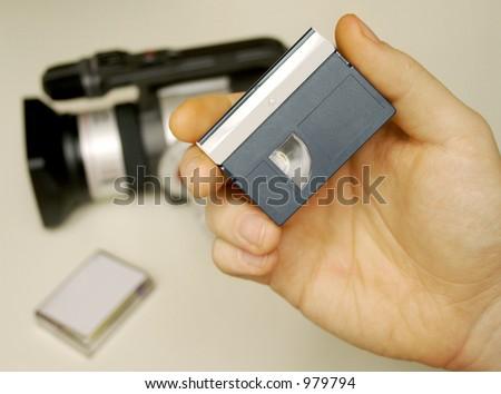Hand Holding a MiniDV Tape - stock photo