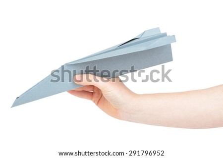 Hand holding a paper airplane isolated on a white background - stock photo