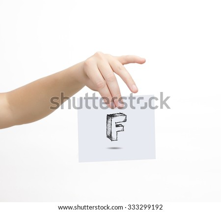 Hand holding a piece of paper with sketchy capital letter F, isolated on white. - stock photo