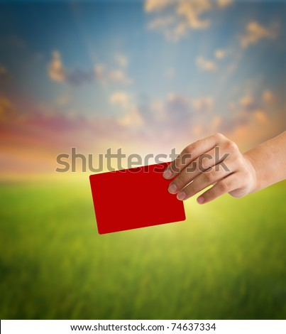 Hand holding a red card - stock photo