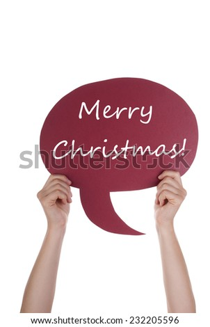 Hand Holding A Red Speech Balloon Or Speech Bubble With Merry Christmas. Isolated Photo - stock photo