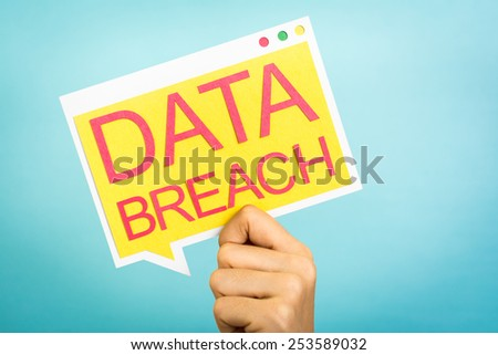 "Hand holding a speech bubble with ""Data Breach"" words. Security concept. - stock photo"