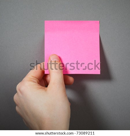 hand holding a sticky paper - stock photo