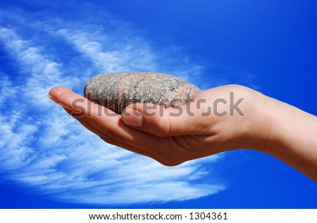 Hand holding a stone