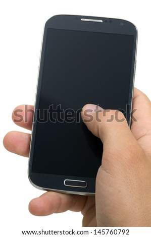 hand holding a touchscreen smartphone - stock photo