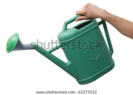 hand holding a watering can - stock photo