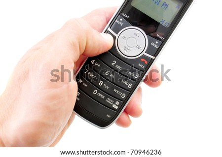 Hand holding a wireless phone isolated on white - stock photo