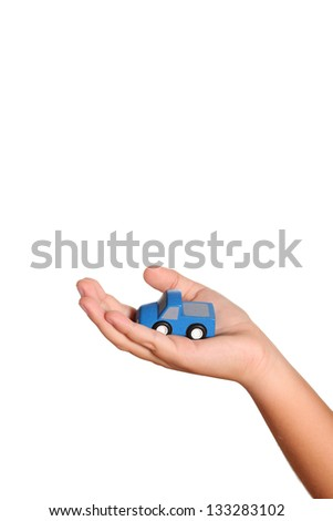 Hand Holding a Wooden Race Car - stock photo