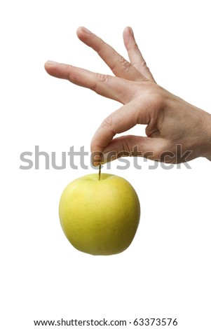 hand holding a yellow apple - stock photo