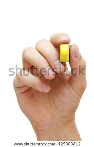 Hand holding a yellow felt tip pen isolated on white with copy space. - stock photo