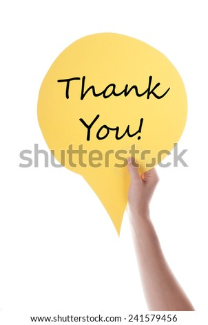 Hand Holding A Yellow Speech Balloon Or Speech Bubble With Thank You. Isolated Photo. - stock photo