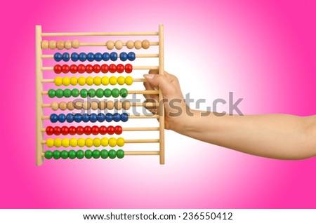 Hand holding abacus on white - stock photo