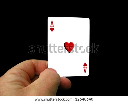 Hand holding ace of hearts which is embossed