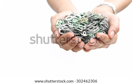 Hand holding aluminum cap can or ring pull of can in white background - stock photo