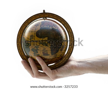 hand holding an antique earth globe - stock photo