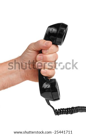 Hand holding an antique telephone receiver.