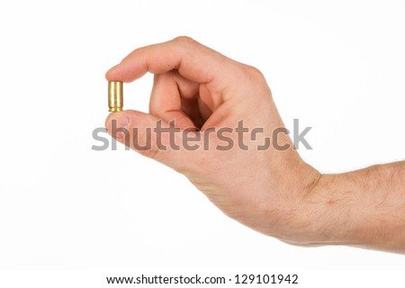 Hand holding an empty bullet shell, isolated on white - stock photo