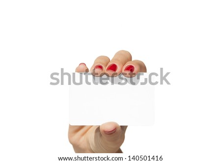 Hand holding an empty business card with a blue sky background - stock photo
