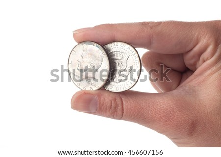 Hand holding an 1968 Kennedy Half Dollar Value coin. Both sides isolated on white background. Old coin.