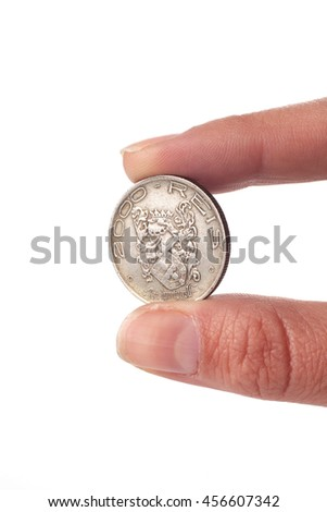Hand holding and old coin of Brazil isolated over white background