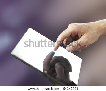 hand holding and pushing tablet, close up