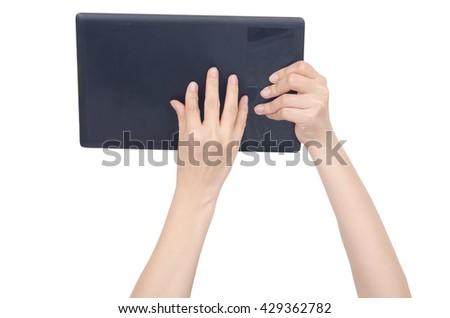 hand holding and touch screen on blank black board isolated with clipping path - stock photo