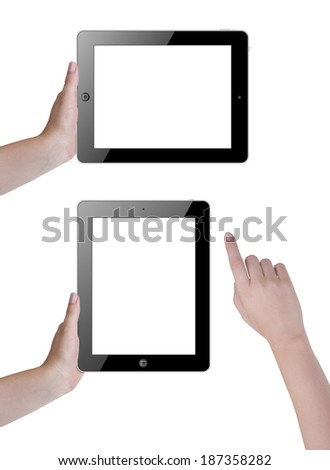 Hand holding and touching tablet computer screen - stock photo