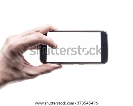 Hand holding and using mobile smartphone with blank screen in horizontal position - stock photo