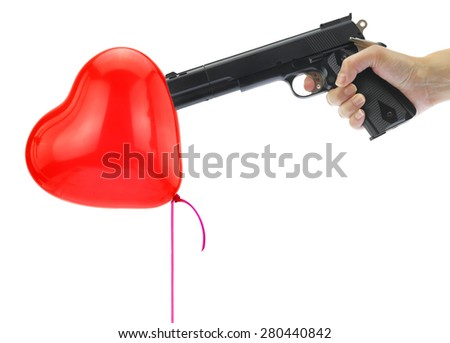 Hand holding at gunpoint a heart balloon isolated on white - stock photo