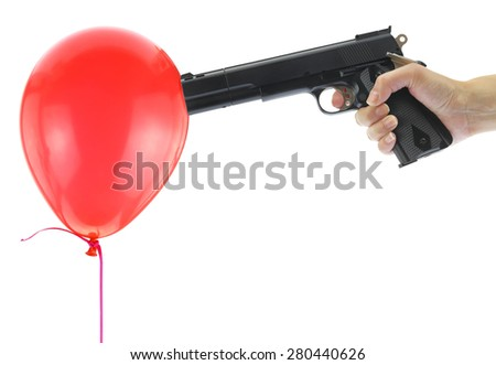 Hand holding at gunpoint a red balloon isolated on white - stock photo
