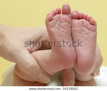 hand holding baby's feet