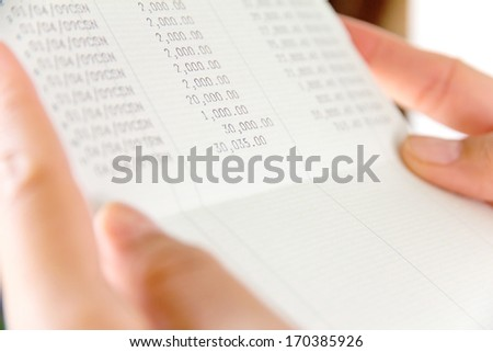 hand holding bank account book,financial concept - stock photo