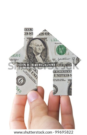 Hand holding banknote house icon - stock photo