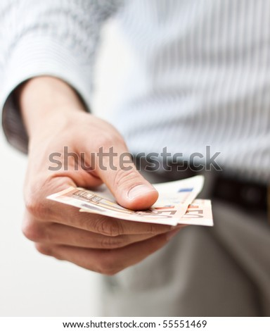 Hand holding banknotes - stock photo