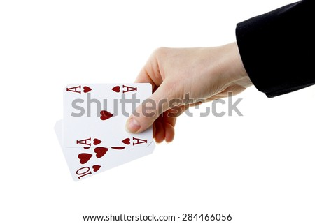 hand holding best classic winning blackjack combination ten and ace of hearts - stock photo