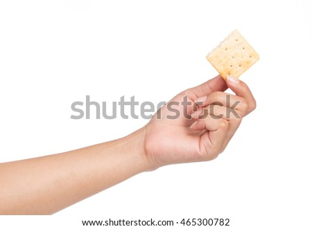 hand holding biscuits isolated on white background