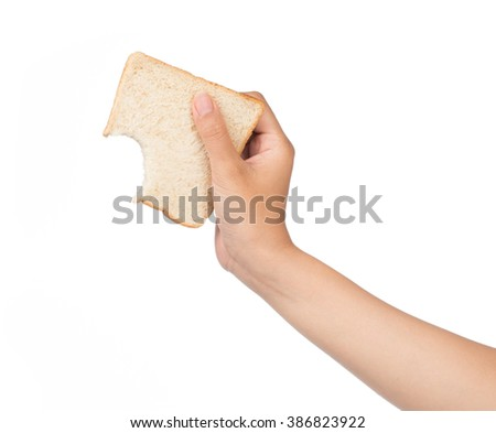 Hand holding bite bread isolated on white background