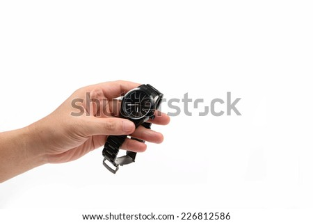 hand holding black watch isolated on white.
