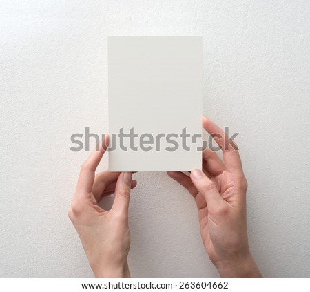 hand holding blank card on white background - stock photo