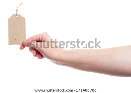 Hand holding blank cardboard tag isolated on white background - stock photo