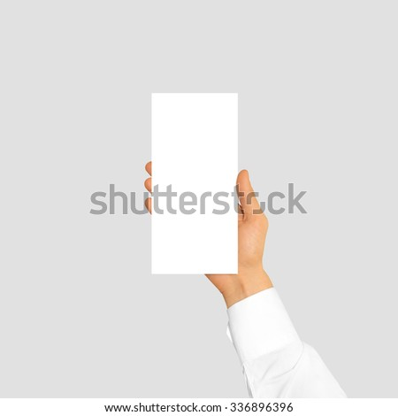 Hand holding blank flyer brochure booklet in the hand. Leaflet presentation. Pamphlet hand businessman. Man show offset paper. Sheet template. Booklet design. Paper sheet display read first person. - stock photo
