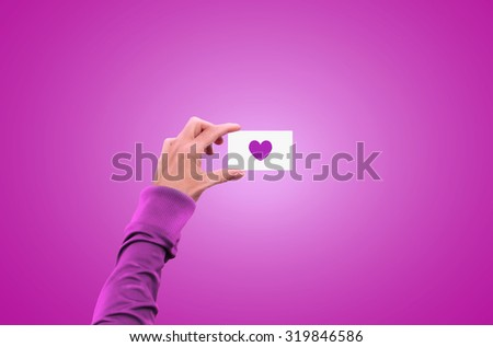 Hand holding blank love symbol business card mock up. Gay lgbt heart lesbian freedom bisexual  transsexual proud rights presentation. Cute sexuality identity mockup. Show your community pride. - stock photo
