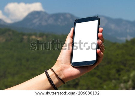 Hand holding blank, white, empty screen smart phone with copy space on natural background. - stock photo