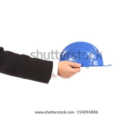 Hand holding blue hard hat isolated - stock photo