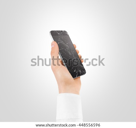 Hand holding broken phone with smashed touch screen, cipping path. Arm hold cracked smartphone, isolated. Smart mobile cellphone display scratch. Telephone monitor problems, need repair. - stock photo
