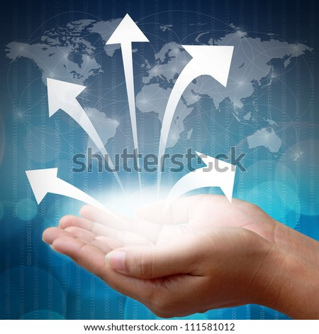 Hand holding business arrow - stock photo
