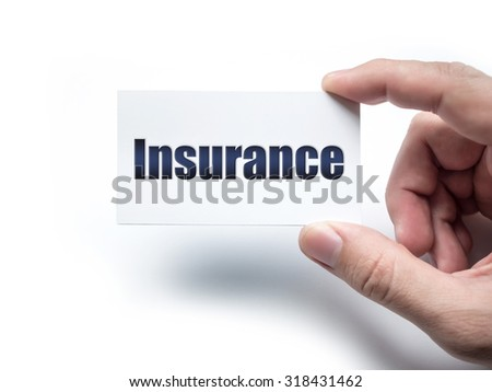 Hand holding business card with Insurance word on the white wall - stock photo