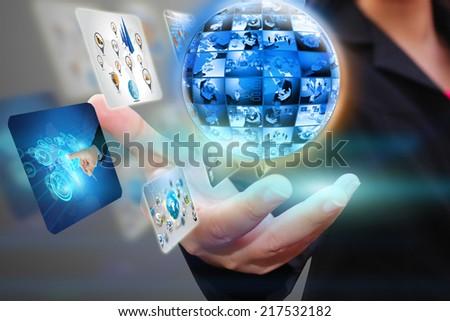 hand holding business world. - stock photo