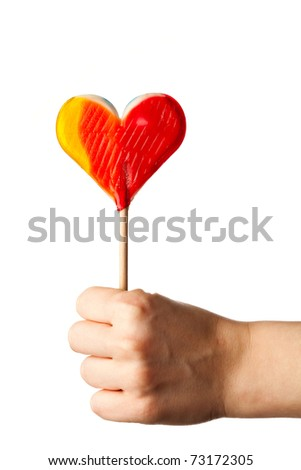 hand holding candy heart isolated on white